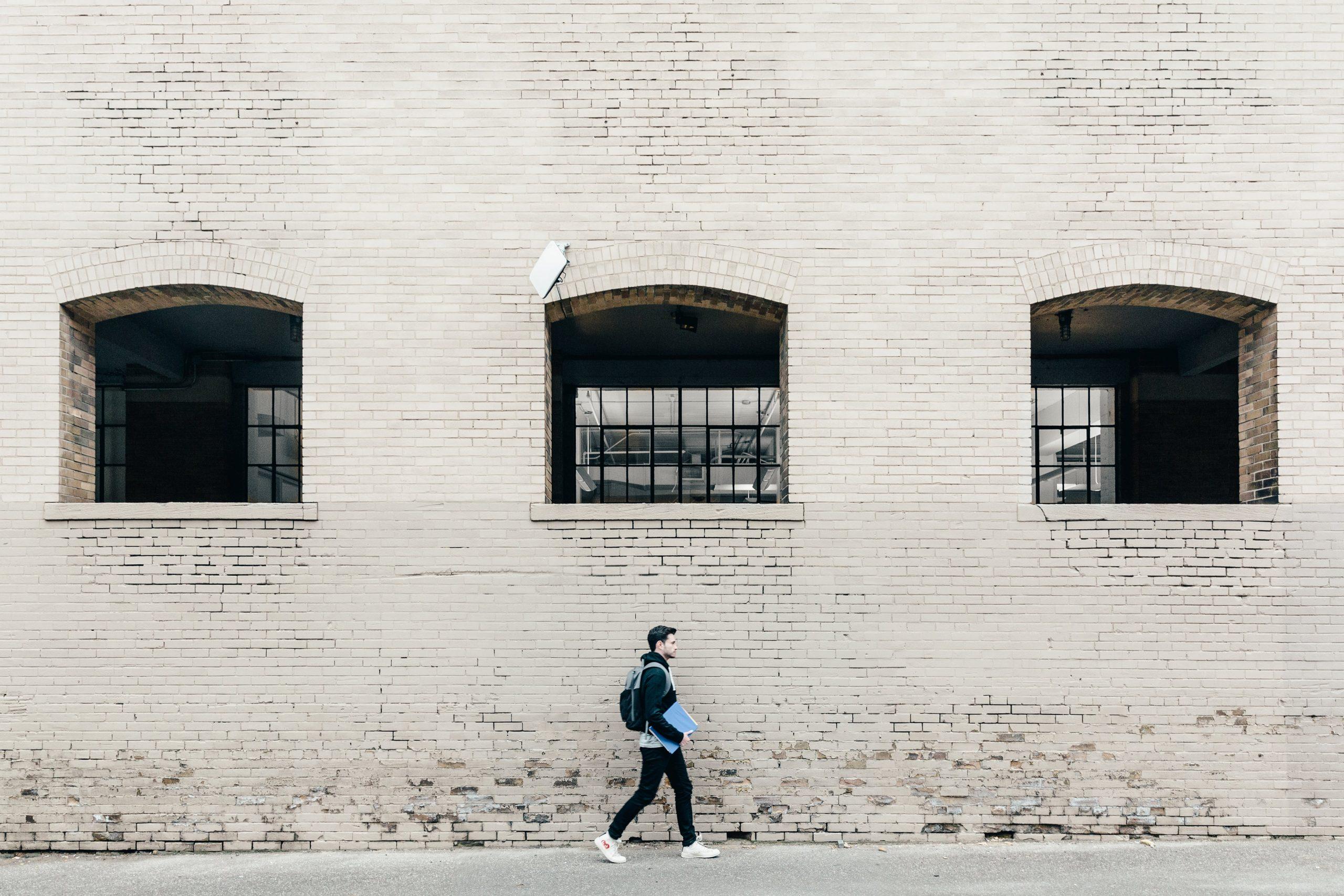 male-student-walking