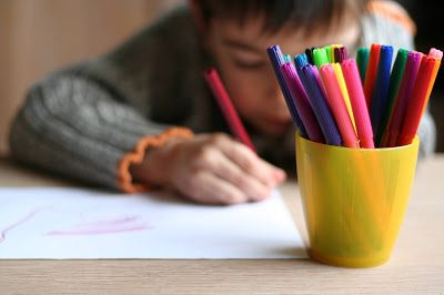 Child drawing a picture whose parent may file a school discrimination complaint after being harassed for his race, ethnicity, gender, sexual orientation and disability.