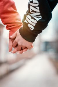 Two youths hold hands- parents have the right to opt their child out of sex education